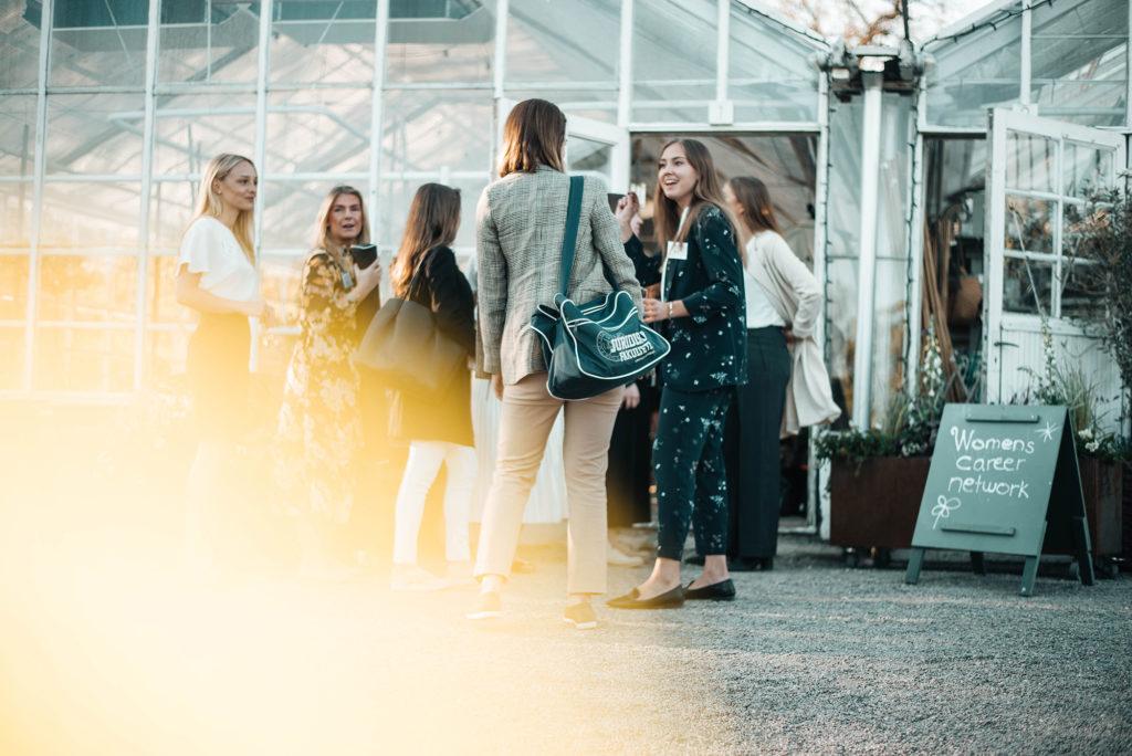 people mingle at event venue